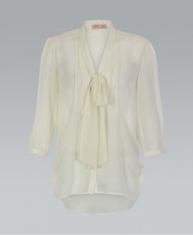 Unique Vintage's own Colvin Blouse is a vintage style top in graceful cream ivory chiffon, featuring a classic button up placket with dainty vertical pleating detail on the front. Affectionally detailed with a retro style yoke back and charming short sleeves with keyhole self tie cuffs and gathering for feminine form.