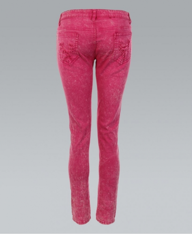 Neon pink skinny jeans